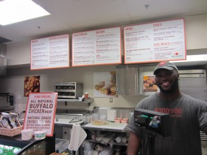 Why is this man smiling? He's serving humanely raised meat at a highway rest stop.